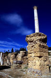 Marble pillar and blue sky in Carthage, Tunisia Royalty Free Stock Photography