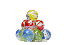 Marble pyramid. Small pyramid of colored glass balls isolated over white background Royalty Free Stock Image