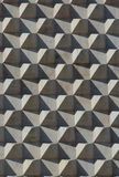 Marble pyramids on wall Royalty Free Stock Image
