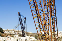 Marble quarry. Cranes and marble blocks at a quarry near Vila Vi�osa, Alentejo, Portugal Stock Image