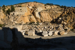 Marble quarry. Abandoned marble quarry - marble block on background Stock Photography