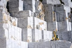 Marble quarry in Carrara italy. The quarries are places where excavation and marble processing takes place for many centuries. For the way in which marble is stock image