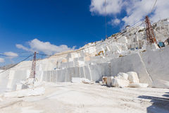 Marble quarry of Carrara in Italy. White marble quarry working site in Carrara, Tuscany, Italy royalty free stock image