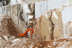 Marble quarry with  excavator in Carrara, Italy Royalty Free Stock Photography