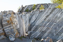 Marble quarry, marble rocks. Marble quarry, marble rocks in the wild in the Republic of Karelia. The natural stone. Ancient faults marble Imperial times. Slices Stock Photo