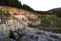 Marble quarry with a mountain landscape surrounded by nature Stock Photos