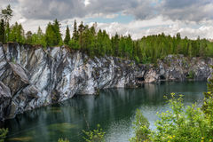 Marble quarry in Ruskeala Park in Republic of Karelia, Russia. Ruskeala - tourist center, located on the ground filled with groundwater former marble quarry Royalty Free Stock Images