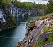 Marble quarry in Ruskeala Park in Republic of Karelia, Russia. Ruskeala - tourist center, located on the ground filled with groundwater former marble quarry Royalty Free Stock Photo