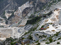 Marble quarry view with hairpin mountain road views, Italy Stock Photo