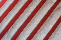 Marble and red steps of staircase at oblique angle Stock Photos
