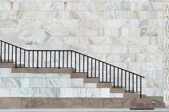 Marble and red stone stair in milan near the cathedral. And steel fence royalty free stock photo