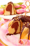 Marble  ring cake for easter. Marble ring cake  poured with chocolate on easter table Royalty Free Stock Images