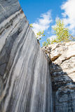 Marble rocks, marble quarry in the wild. Marble rocks, marble quarry in the wild in the Republic of Karelia. The natural stone. Ancient faults marble Imperial Royalty Free Stock Photography