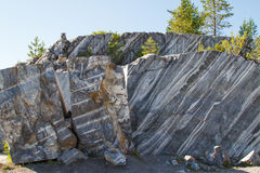 Marble rocks in the wild. Marble quarry, marble rocks in the wild in the Republic of Karelia. The natural stone. Ancient faults marble Imperial times. Slices of Royalty Free Stock Image
