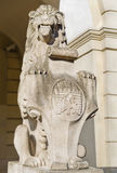 Marble sculpture - a lion near the town hall in Lviv, Ukraine Royalty Free Stock Images