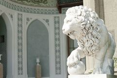 Marble sculpture of a lion in Vorontsov Palace of Crimea. Alupka, Ukraine - September 12, 2017: Marble sculpture of a lion in Vorontsov Palace of Crimea royalty free stock images