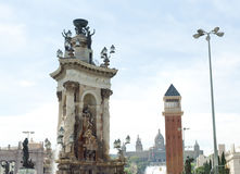 Marble sculpture monument and venetian tower in Plaza de Espana, on background National Art Museum, Barcelona Royalty Free Stock Photo