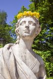 Marble sculpture with a wreath of dandelions Royalty Free Stock Photography