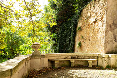 Marble seating area at the Botanic Garden (Orto Botanico),Trastevere, Rome, Italy. Area of the gardens which are between the Gianicolo (Janiculum) hill and the Royalty Free Stock Images