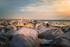 Marble shore in Thassos island during sunset Stock Images