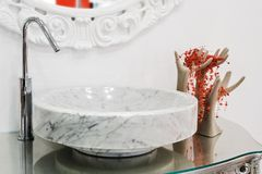 Marble sink. And the metal tap in a bathroom Stock Photography