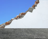 Marble slab floor with crack white bricks wall and blue sky Royalty Free Stock Photography