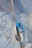 Sturdy rope and closure that holds marble slabs. Marble slabs stored in the quarry in Carrara - Italy Royalty Free Stock Photography