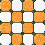 Marble square floor tiles with green rhombs seamless pattern texture background - orange and white color Stock Photography