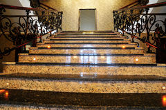 Marble stairs. Inside hotel lobby with mirror frame on the top Stock Photos
