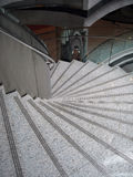 Marble Staircase. A spiral marble like staircase with chrome handle bar royalty free stock photos