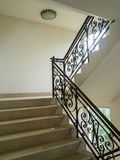Marble staircase with stairs in luxury hall. The Marble staircase with stairs in luxury hall royalty free stock photography