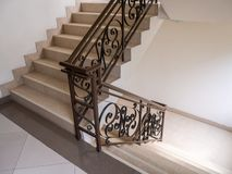 Marble staircase with stairs in luxury hall. The Marble staircase with stairs in luxury hall stock image