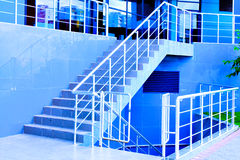 Marble staircase with a steel handrail Stock Photos