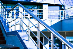 Marble staircase with a steel handrail. In a modern building Stock Photo