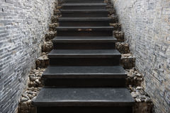 Marble staircase with stone wall Royalty Free Stock Photography