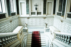 Marble stairs. With red carpet Stock Photo