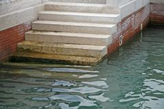 Marble stairs that descend to the sea. Water Royalty Free Stock Photos