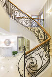 Marble stairs with elegant forged handrail Royalty Free Stock Photos
