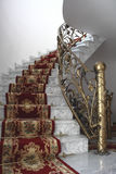 Marble stairs. And gold balustrade Royalty Free Stock Photo