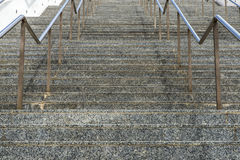 Marble stairs with metal railing Royalty Free Stock Photos