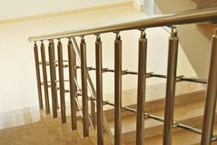 Marble stairs and railings. Beige marble stairs and stainless railings royalty free stock photography