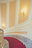 Marble stairs with red carpet Royalty Free Stock Photography