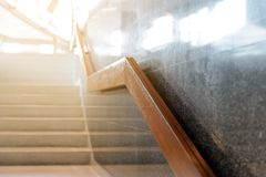 Marble stairs with wooden handrail in building for step up or down safety. Interior stock images