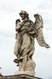 Marble statue of Angel with the Crown of Thorns from the Sant`Angelo Bridge in Rome Royalty Free Stock Photos