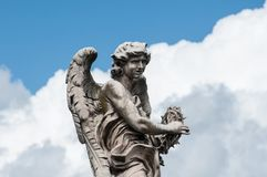 Marble statue of angel in Rome. Marble statue of angel, designed by Bernini, on Saint Angel Bridge - Rome, Italy Stock Photo