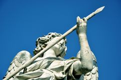 Statue of angel holding the holy lance. Marble statue of angel holding the Holy Lance of Longinus. Sant`Angelo bridge balustrade. Rome, Italy Royalty Free Stock Image