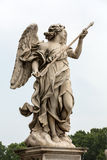 Marble statue of Angel with the Lance. By Domenico Guidi from the Sant'Angelo Bridge in Rome, Italy Stock Image