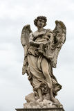 Marble statue of Angel with the Whips Stock Photos