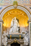 Marble statue of the bishop and his congregation in Basilica di San Giovanni in Laterano in Rome, capital of Italy Stock Photo