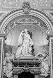 Marble statue of the bishop and his congregation in Basilica di San Giovanni in Laterano in Rome, capital of Italy. Marble statue of the bishop and his stock photos